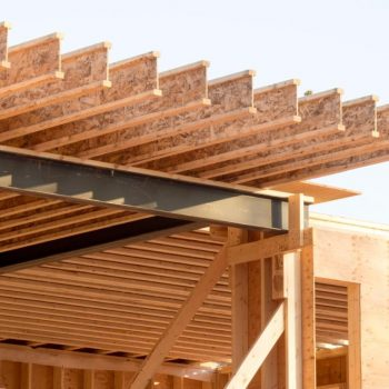 engineered wood joists on a steel beam in a house under construction